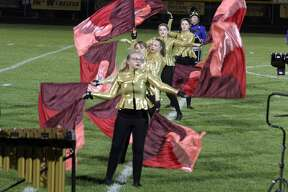 Bad Axe's marching band, cheerleader squad and members of the color guard put on a final performance at halftime during Friday night's football game.