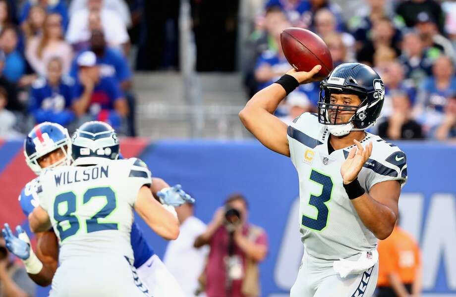 """CBS Sports' John BreechSeattle earned a B+ in Breech's weekly grades thanks in large part to the arm (and legs) or Russell Wilson. """"If the secret to beating the Seahawks is making Russell Wilson throw the ball, then the rest of the NFL might need to come up with a new secret because the old one might not be working anymore,"""" Breech wrote. """"Wilson had one of the best games of his career, finished 27 of 39 for 334 yards and three touchdowns."""" Photo: Al Bello/Getty Images"""
