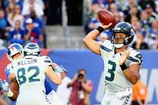EAST RUTHERFORD, NJ - OCTOBER 22:  Quarterback  Russell Wilson #3 of the Seattle Seahawks throws a pass against the New York Giants during the first quarter of the game at MetLife Stadium on October 22, 2017 in East Rutherford, New Jersey.  (Photo by Al Bello/Getty Images)