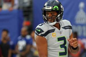 EAST RUTHERFORD, NJ - OCTOBER 22:  Quarterback  Russell Wilson #3 of the Seattle Seahawks smiles during warm-ups before taking on the New York Giants at MetLife Stadium on October 22, 2017 in East Rutherford, New Jersey.  (Photo by Abbie Parr/Getty Images)