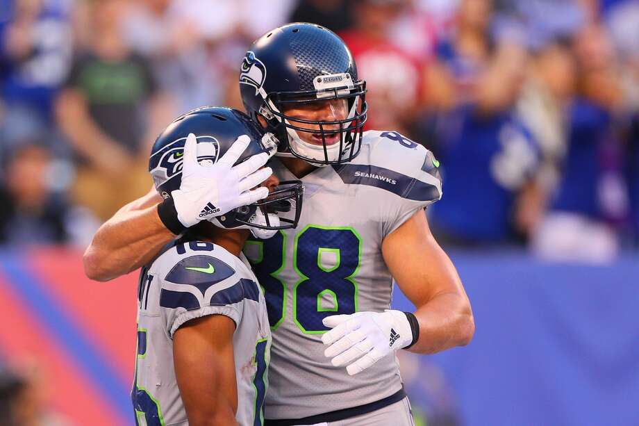 EAST RUTHERFORD, NJ - OCTOBER 22:  Seattle Seahawks tight end Jimmy Graham (88) hugs Seattle Seahawks wide receiver Tyler Lockett (16) during the National Football League game between the New York Giants and the Seattle Seahawks on October 22, 2017, at MetLife Stadium in East Rutherford, NJ.  (Photo by Rich Graessle/Icon Sportswire via Getty Images) Photo: Icon Sportswire/Icon Sportswire Via Getty Images