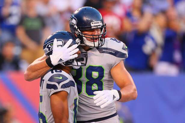 EAST RUTHERFORD, NJ - OCTOBER 22:  Seattle Seahawks tight end Jimmy Graham (88) hugs Seattle Seahawks wide receiver Tyler Lockett (16) during the National Football League game between the New York Giants and the Seattle Seahawks on October 22, 2017, at MetLife Stadium in East Rutherford, NJ.  (Photo by Rich Graessle/Icon Sportswire via Getty Images)