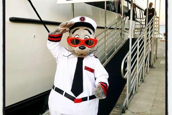 Giants mascot Lou Seal celebrates the launch of Giants Enterprises new yacht, the California Spirit. Oct. 17, 2017.