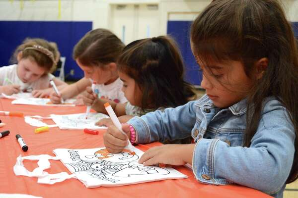Hard-working artists, from left, Catherine McBrien, 4, Penny McBrien, 6, Sonia Hall, 2, and Anika Hall, 4, all from Stamford, at the Holly Pond Pre-School's 21st annual Family Fun Day at the Darien YMCA, Sunday, Oct. 22, 2017, in Darien, Conn.