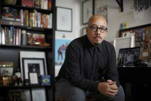 """Bestselling author and Spurs fan Shea Serrano, who penned """"Basketball (and Other Things): A Collection of Questions Asked, Answered, Illustrated,"""" is pictured in his office in Houston. He's branching into TV with two upcoming series."""