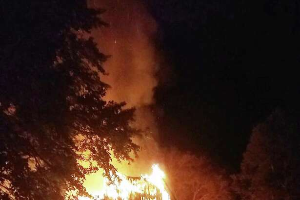 A 200-year-old barn was destroyed in a fire on South Avenue Sunday, Oct. 22 in New Canaan, Conn.