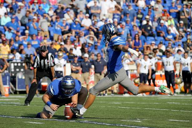 Memphis freshman Riley Patterson, right, attempts a kick during a game against Navy on Oct. 14 inside the Liberty Bowl in Memphis. Patterson is a 2017 graduate of Edwardsville.