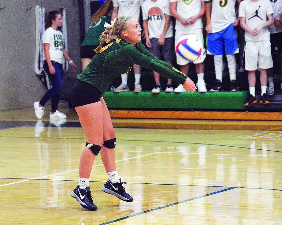 Metro-East Lutheran senior libero Emily Schwarz makes a dig during a regular season match for the Knights inside Thomas Hooks Gymnasium.