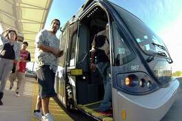 Jimmy Aragon joins others in boarding a VIA Primo rapid transit bus along Medical Drive in 2014. VIA and the city will consider seven rapid transit corridors that could accommodate either speedier buses or light rail, according to citizen preference.