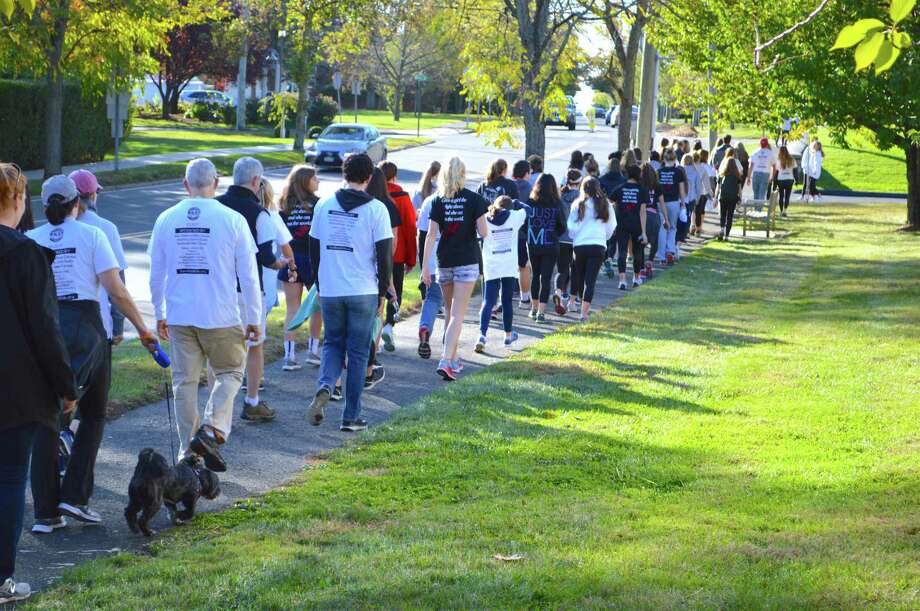 Around 150 people took part in the Walk the Walk-A-Thon for Save God's Kids, held at St. Aloysius Church, Saturday, Oct. 21, 2017, in New Canaan, Conn. Photo: Jarret Liotta / For Hearst Connecticut Media / New Canaan News Freelance