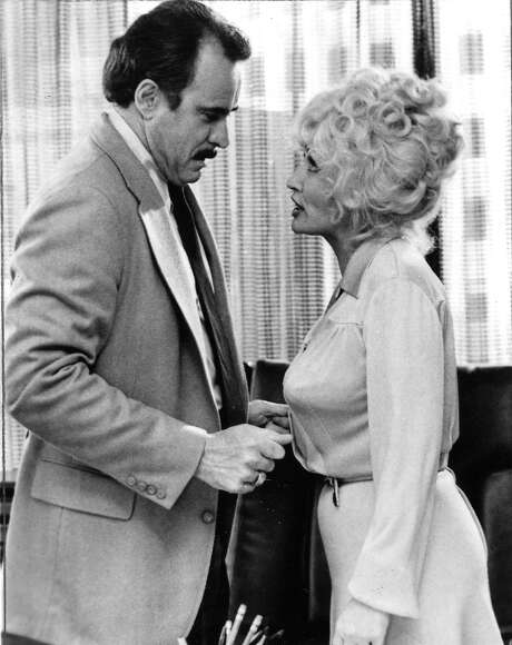 Dabney Coleman and Dolly Parton in 'Nine to Five' Photo: IPC Films