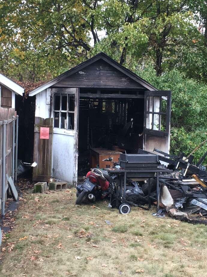 Fire destroyed a garage in Old Greenwich Monday around noon. Photo: / Robert Marchant / Hearst Media
