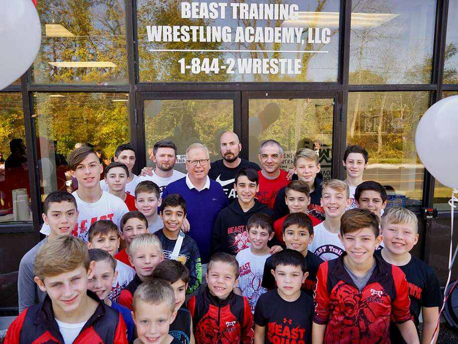 Danbury Mayor Mark Boughton joins Beast Training Wrestling Academy owners Fred Mills and Nicky Weyer, as well as Beast wrestlers at the grand opening of the club's new facility on Eagle Road in Danbury, Conn., on Saturday, Oct. 21, 2017. (Jose Villaluz photo) Photo: Contributed Photo / Hearst Connecticut Media / The News-Times Contributed