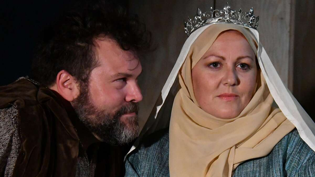 """Henry II (Steven Westdahl) gets major shade from Eleanor of Aquitaine (Catherine Luedtke) during the Christmas of 1183 in Custom Made Theatre Company's """"The Lion in Winter."""""""