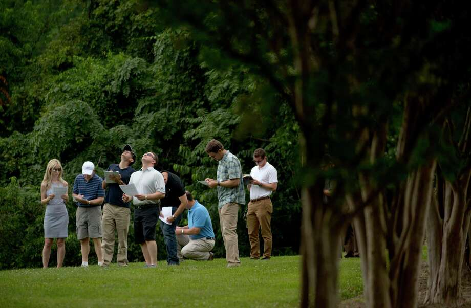 Brendan Schulman and members of Task Group 1 monitor drone altitudes in Reston, Va., in July. Schulman, the group's co-chair, told a reporter the gathering was confidential and being held on private property, before walking with others out of earshot. Photo: Reza A. Marvashti/For The Washington Post. / THE WASHINGTON POST