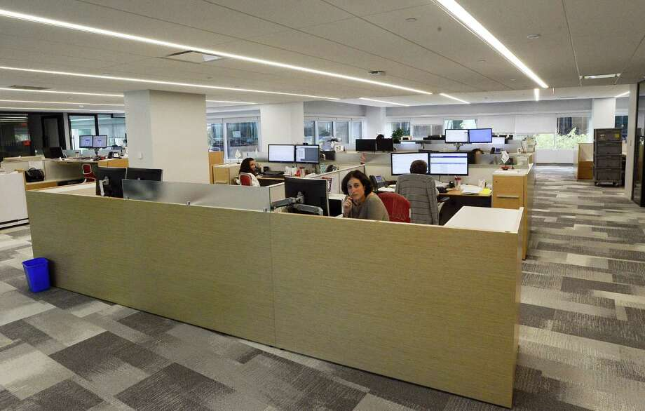 """Reinsurer PartnerRe has relocated its lead U.S. offices from Greenwich to Stamford, where it occupies about 57,000 square feet on the fourth floor of the 200 building at the First Stamford Place complex. The offices use an """"open office concept,"""" where employees are assigned cubicle spaces rather than individual offices. Photo: Matthew Brown / Hearst Connecticut Media / Stamford Advocate"""