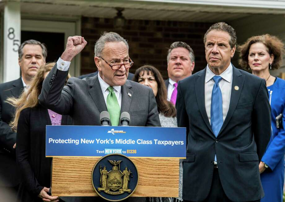 Senate Minority Leader Charles Schumer, left, and Gov. Andrew Cuomo joined forces on the front lawn of 85 University Street on Monday, Oct. 23, 2017, to call on New York Representatives to protect middle-class homeowners by opposing repeal of State and Local Tax deductions and any tax bill that proposes it at a press conference held in Bethlehem, N.Y.  (Skip Dickstein/Times Union) Photo: SKIP DICKSTEIN, Albany Times Union / 20041915A