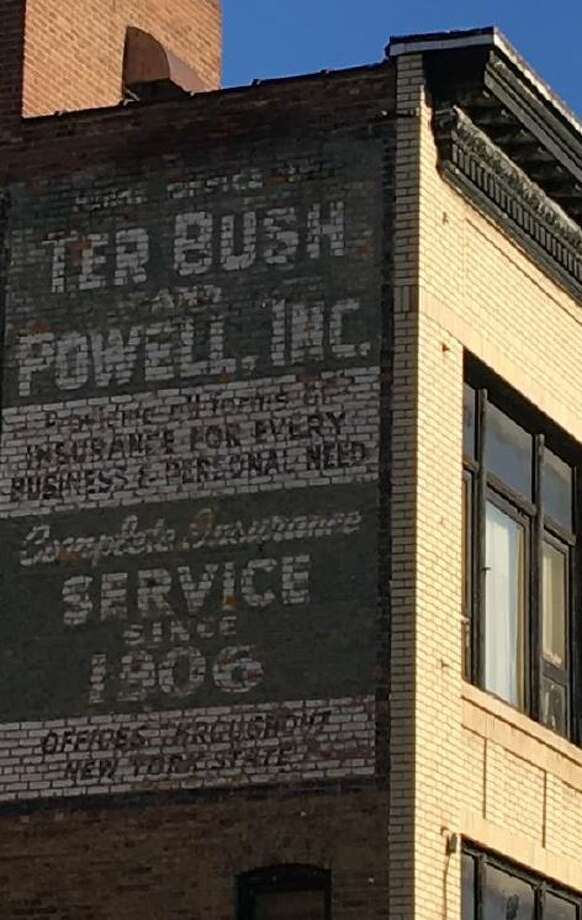 A sign for the former Ter Bush and Powell insurance company remains on the side of the building at 148 Clinton Street in Schenectady Photo: Nearing, Brian, Schenectady Metroplex Development Authority