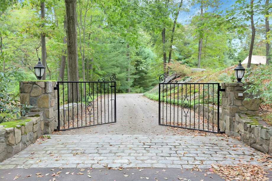 This 5,351-square-foot, 12-room house sits on a gated and secluded property in the northern end of town not far from Danbury Road (Route 7) and all its amenities.