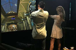 A new virtual gun range is opening Tuesday at Crossgates Mall in Guilderland. The 55,000-square-foot space features 14 lounges, each with a 12-by-6-foot screen, hit-detection camera, couch, projector and four replica firearms that look, feel and weigh like their actual counterparts.