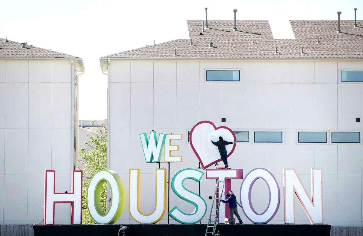 "David Adickes' ""We Heart Houston"" sign on the feeder road of I-10."