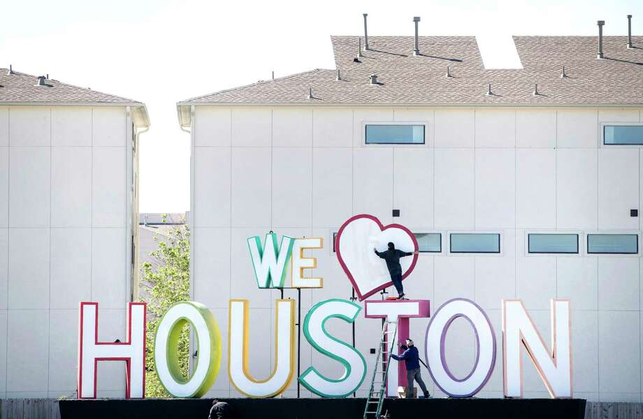 "David Adickes' ""We Heart Houston"" sign on the feeder road of I-10. It's currently moving to an area near the popular 8th Wonder Brewery just east of downtown Houston.Learn more about Adickes and also inspiring Houston icons... Photo: Jon Shapley, Staff / © 2017  Houston Chronicle"