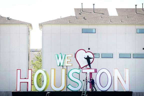 "David Adickes' ""We Heart Houston"" sign on the feeder road of I-10."