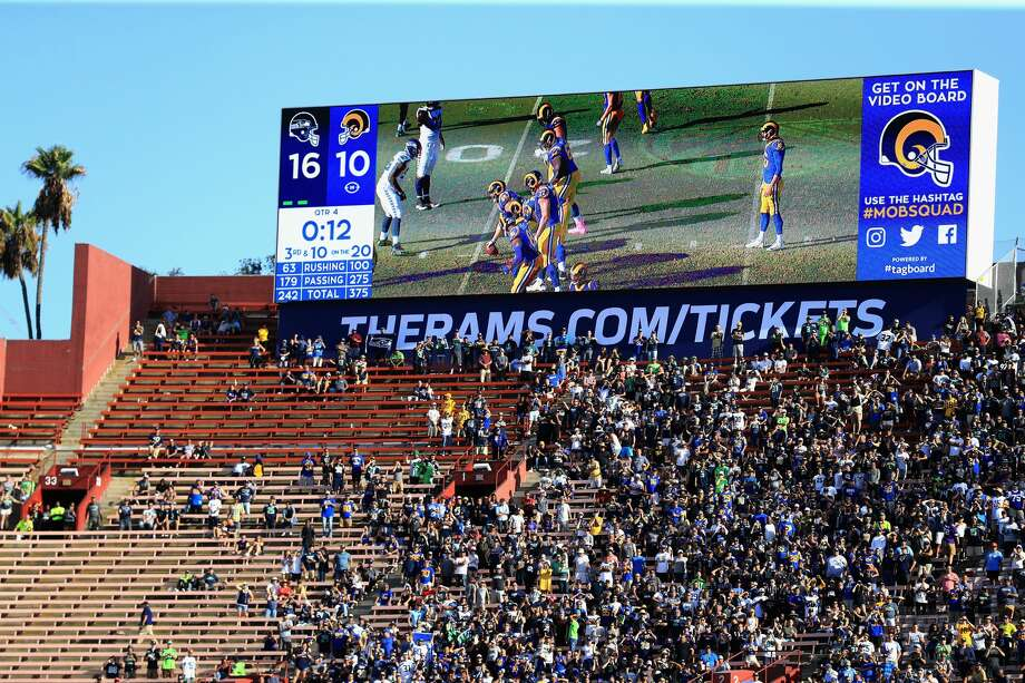 Fans watch a a game between the Los Angeles Rams and the Seattle Seahawks  at Los Angeles Memorial Coliseum on October 8. Photo: Sean M. Haffey/Getty Images
