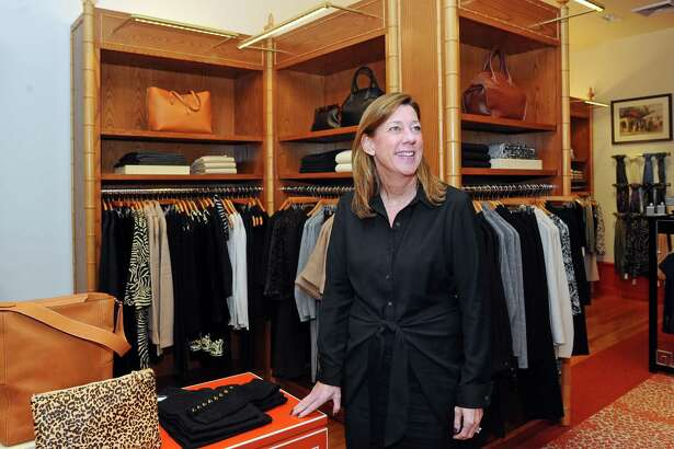 J.McLaughlin CEO Mary Ellen Coyne poses for a photo inside the East Putnam Avenue J.McLaughlin store in Greenwich, Conn. on Thursday, Oct. 19, 2017.