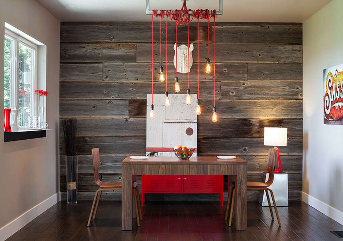 #1 - Reclaimed Wood Paneling a wall, or a portion of it, with reclaimed wood can add interest and texture to any room. And here's the cool thing about it: This trend has become so popular, you can buy reclaimed wood paneling (or a reasonable facsimile of it) at your local home improvement store. (Contemporary dining room design by Jordan Iverson Signature Homes)