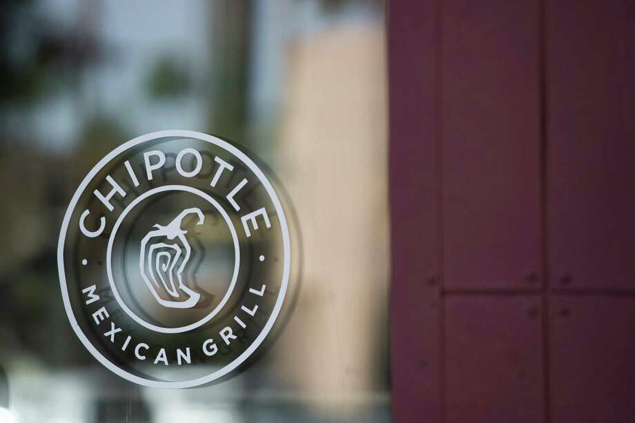 Chipotle Mexican Grill Inc. signage is displayed on the window of a restaurant in Tempe, Arizona, U.S., on Saturday, Oct. 21, 2017. Chipotle Mexican Grill Inc. is scheduled to release earnings figures on October 24. On Chipotle's last earnings call in July, company executives mentioned queso about two dozen times, saying customers had been requesting the product for years and that it could help boost sales, but some analysts are skeptical. Photo: Caitlin O'Hara /Bloomberg / © 2017 Bloomberg Finance LP