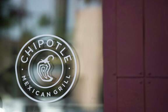 Chipotle Mexican Grill Inc. signage is displayed on the window of a restaurant in Tempe, Arizona, U.S., on Saturday, Oct. 21, 2017. Chipotle Mexican Grill Inc. is scheduled to release earnings figures on October 24. On Chipotle's last earnings call in July, company executives mentioned queso about two dozen times, saying customers had been requesting the product for years and that it could help boost sales, but some analysts are skeptical.
