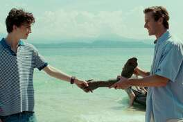 """Armie Hammer, right, and Timothee Chalamet in the film, """"Call Me By Your Name,"""" based on the Andre Aciman novel. Hammer recorded the audiobook. He's one of a number of movie stars narrating audiobooks. In September, audiobooks accounted for 48 percent of the Danbury Library's circulation."""