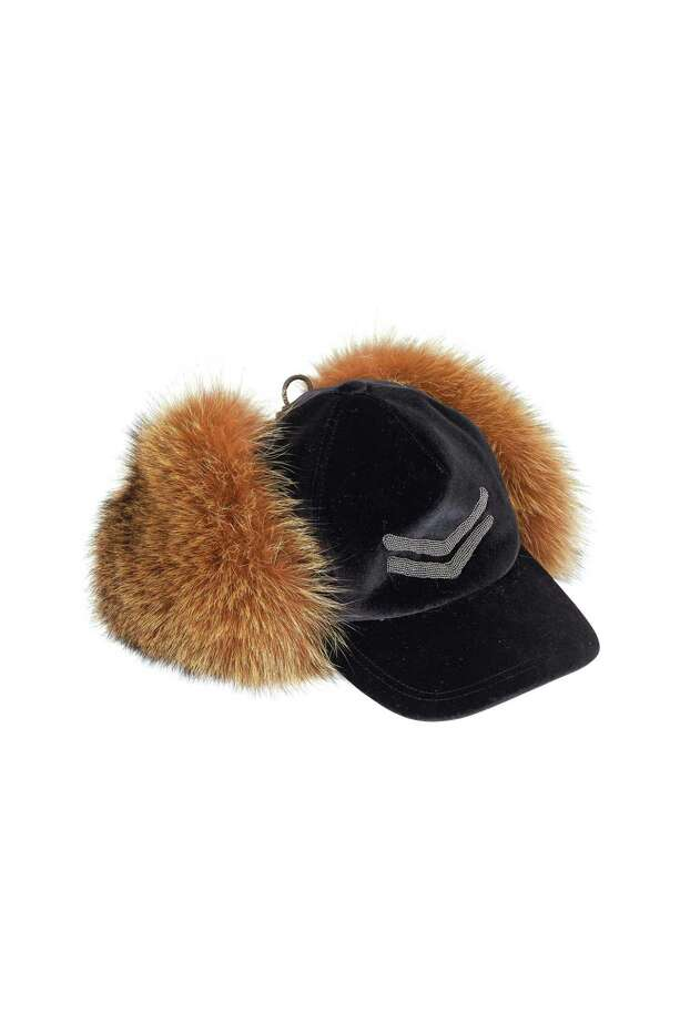 This Brunello Cucinelli black velvet cap with fox fur ear flaps is available for purchase on the Richards of Greenwich website. Photo: Mitchell Stores / Contributed Photo / Connecticut Post contributed