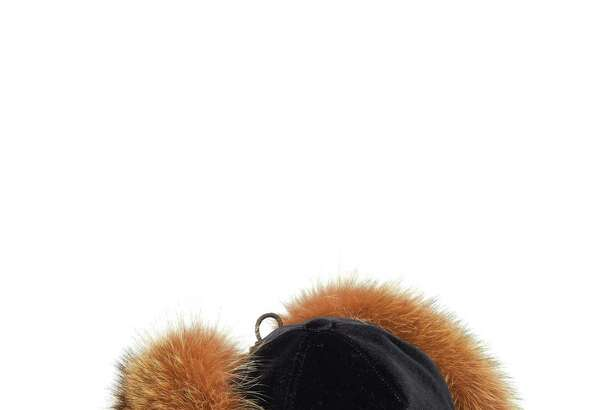 This Brunello Cucinelli black velvet cap with fox fur ear flaps is available for purchase on the Richards of Greenwich website.
