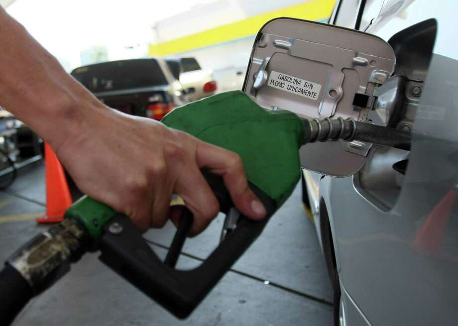 Are gasoline prices heading higher?  CONTINUE to see the price of gasoline in Texas' biggest cities.  Photo: JUAN BARRETO, Staff / AFP