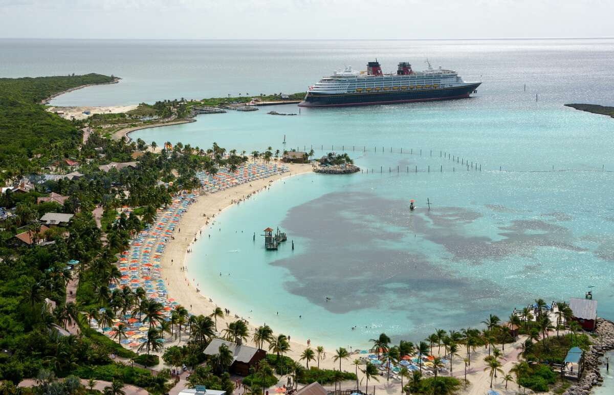 The Disney Wonder docks at Castaway Cay, Disney's 1,000-acre private island in the tropical waters of the Bahamas, reserved exclusively for Disney Cruise Line guests. (Todd Anderson, photographer) Source: Disney Cruise Line
