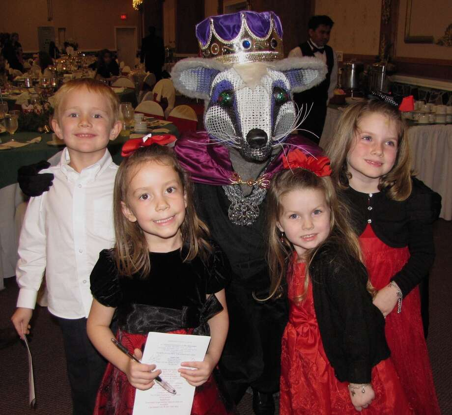 "Charlie Kohrs, Grace Walker, Megan Carroll and Riley Carroll of Richmond with the ""Rat King"" from BalletForte's ""The Nutcracker."" Photo: Courtesy Photo"