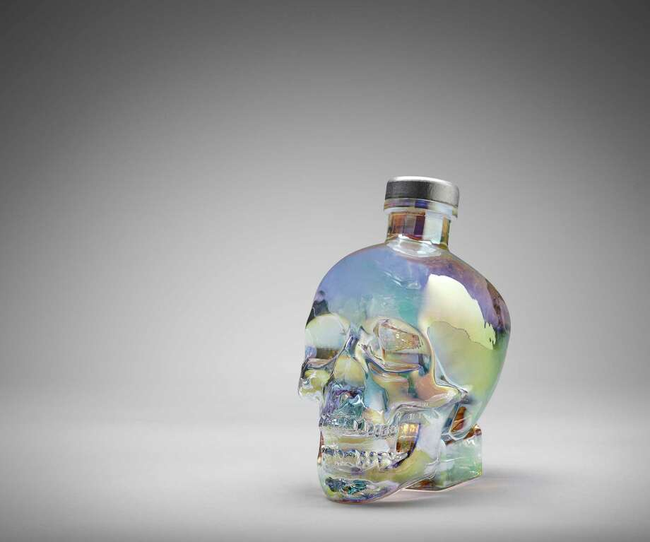 Crystal Head Aurora is a new expression of Crystal Head Vodka housed in a glass skull bottle with iridescent finish. Photo: Crystal Head Vodka / ©2015 Christopher Gentile c/o ImagingTree.com