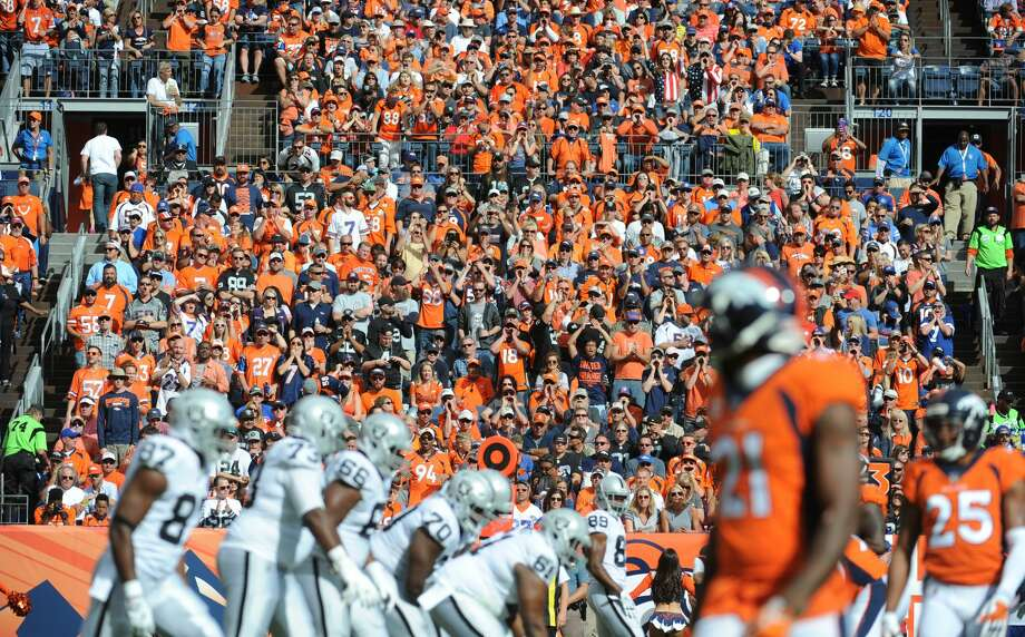 Denver Broncos fans cheer the defense in the first half of the game against the Oakland Raiders in Denver on October 1. Photo: Steve Nehf/Denver Post Via Getty Images