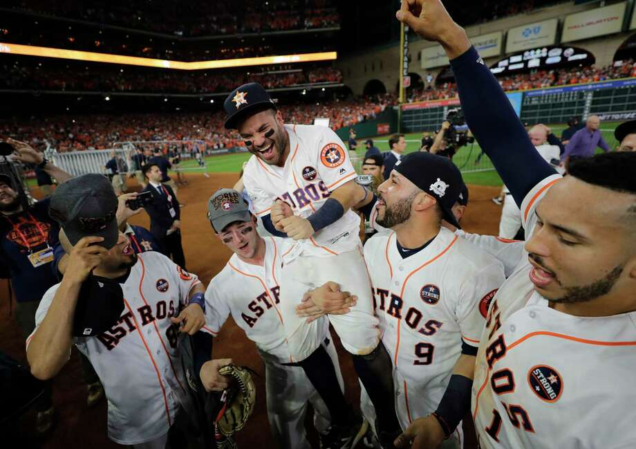 Houston Astros' Jose Altuve is lifted by teammates after Game 7 of baseball's American League Championship Series against the New York Yankees Saturday in Houston. The Astros won 4-0 to win the series. (AP Photo/David J. Phillip) Photo: David J. Phillip, STF / Copyright 2017 The Associated Press. All rights reserved.