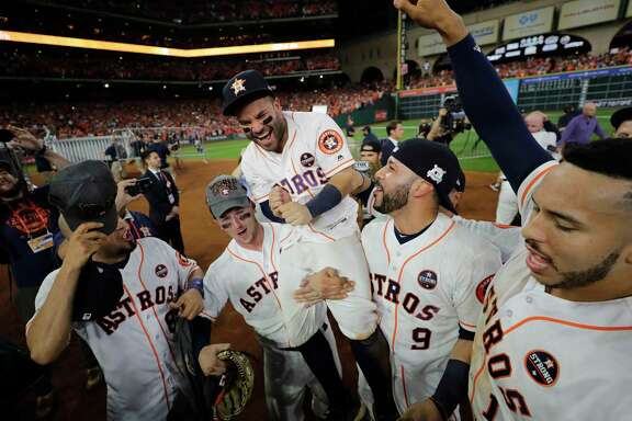 Houston Astros' Jose Altuve is lifted by teammates after Game 7 of baseball's American League Championship Series against the New York Yankees Saturday in Houston. The Astros won 4-0 to win the series. (AP Photo/David J. Phillip)