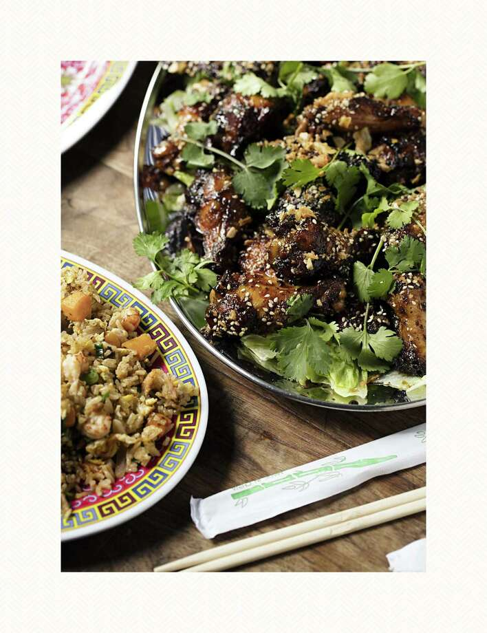 """Fish-Sauce Chicken Wings and Vietnamese Crawfish Fried Rice from Houston chef Chris Shepherd is included in """"America the Great Cookbook."""" Photo: Lottie Hedley"""