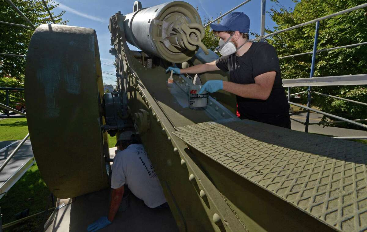 Workers with Culture Preservation and Restoration including Adam McGowan complete the final painting work on the 1873 French cannon donated to Norwalk after World War l and situated on the Norwalk Green Saturday, October 21, 2017, in Norwalk, Conn. The cannon is undergoing a $15,950 sandblasting and repainting to protect it against the elements.