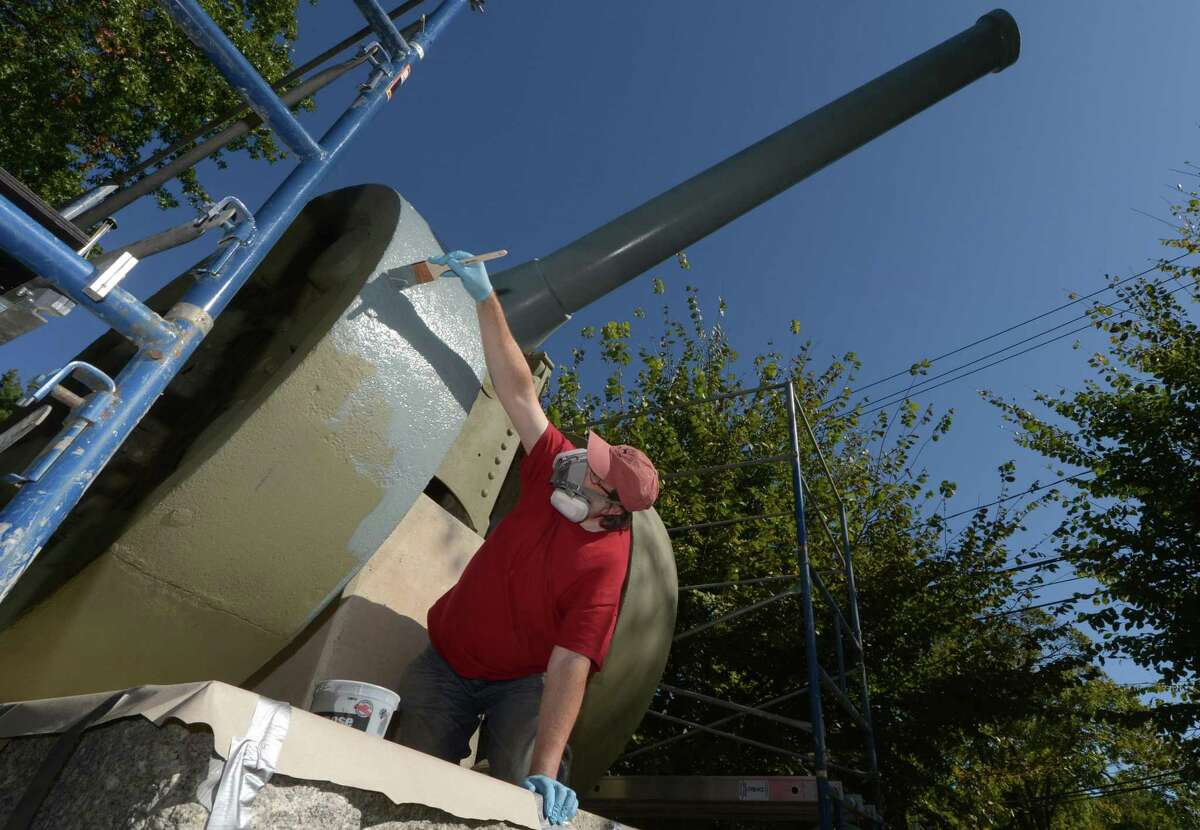 Workers with Culture Preservation and Restoration including Gary McGowan complete the final painting work on the 1873 French cannon donated to Norwalk after World War l and situated on the Norwalk Green Saturday, October 21, 2017, in Norwalk, Conn. The cannon is undergoing a $15,950 sandblasting and repainting to protect it against the elements.