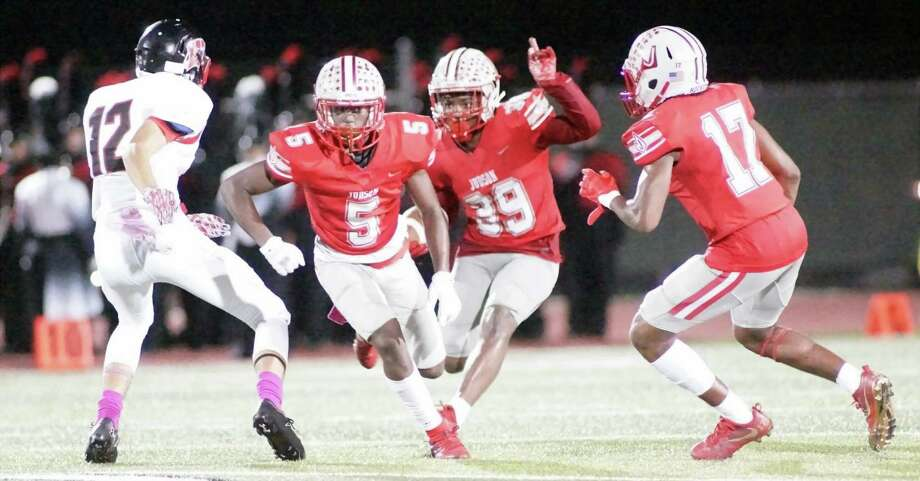 Judson's Rashad Wisdom (39) follows the blocks of Kishaun Fisher (5) and Chris Mills (17) en route to a 75-yard kickoff return for a touchdown. Wisdom's touchdown was the turning point for Judson in its 49-14 win Friday over the Wagner Thunderbirds. Photo: Lavon Brown For The NE Herald