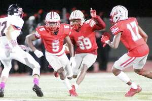 Judson's Rashad Wisdom (39) follows the blocks of Kishaun Fisher (5) and Chris Mills (17) en route to a 75-yard kickoff return for a touchdown. Wisdom's touchdown was the turning point for Judson in its 49-14 win Friday over the Wagner Thunderbirds.