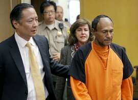 FILE - In this July 7, 2015 file photo, Jose Ines Garcia Zarate, right, is led into the courtroom by San Francisco Public Defender Jeff Adachi for his arraignment at the Hall of Justice in San Francisco.  The murder trial started Monday, Oct. 23, 2017, for Garcia Zarate, a Mexican man who set off a national immigration debate after he shot and killed Kate Steinle on a San Francisco pier on July 1, 2015. Garcia Zarate has said the shooting was accidental. (Michael Macor/San Francisco Chronicle via AP, Pool, File)