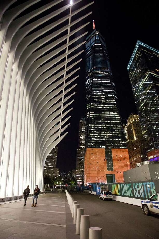 One World Trade Center stands lit in orange to support a bid for Amazon.com Inc.'s second headquarters in New York, U.S., on Wednesday, Oct. 18, 2017. More than 100 cities will bid to be the location of Amazon's second headquarters, dubbed HQ2. Amazon received 238 proposals from cities, states, districts and territories interested in hosting the company's second headquarters. Photo: Michael Nagle /Bloomberg / © 2017 Bloomberg Finance LP