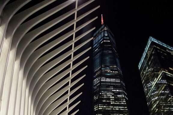 One World Trade Center stands lit in orange to support a bid for Amazon.com Inc.'s second headquarters in New York, U.S., on Wednesday, Oct. 18, 2017. More than 100 cities will bid to be the location of Amazon's second headquarters, dubbed HQ2. Amazon received 238 proposals from cities, states, districts and territories interested in hosting the company's second headquarters.